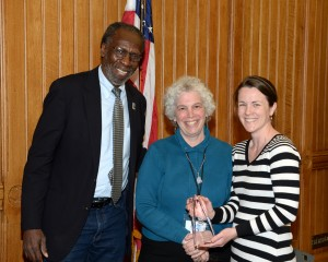 Cathy Lechowicz, right, displaying her award with William Dyson, chairman of the Connecticut Commission on Community Service, and Jane Ciarleglio, executive director of the commission.