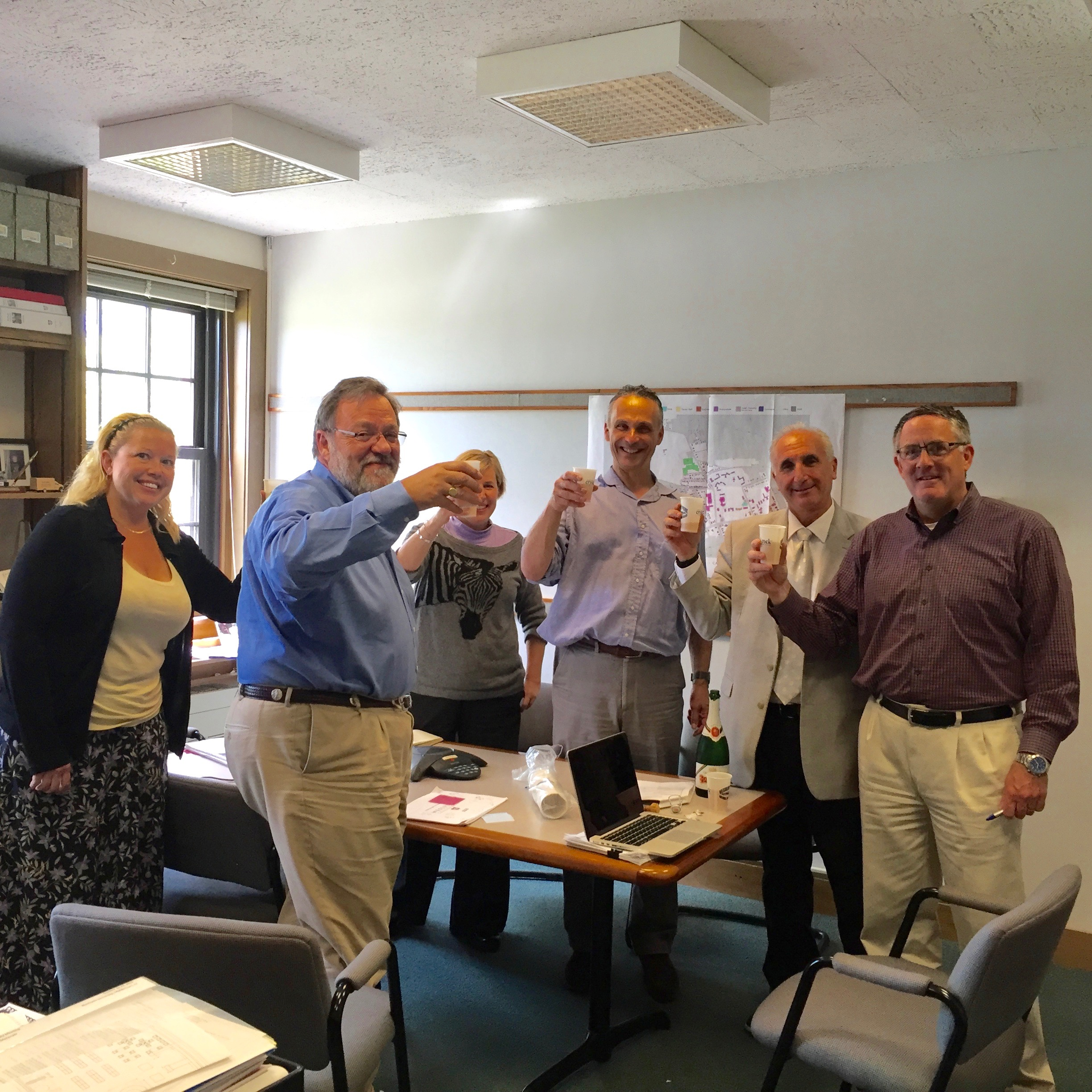 Finance team Toasting Century Bond
